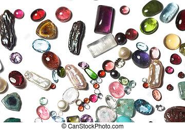 Miscellaneous semi-precious stones on white background.