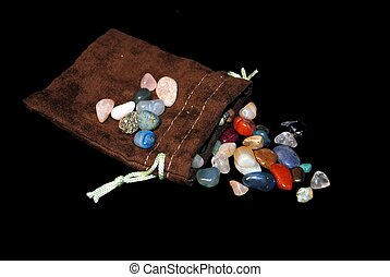 Semi Precious Stones with a velvet pouch.