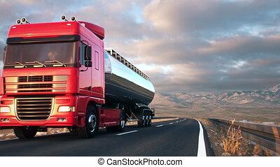semi-trailer tank truck driving along a desert road - A tank...