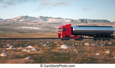 semi-trailer tank truck driving along a desert road -...