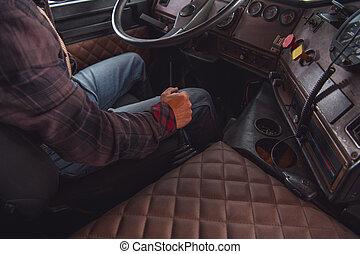 Semi Truck Driver Behind the Wheel