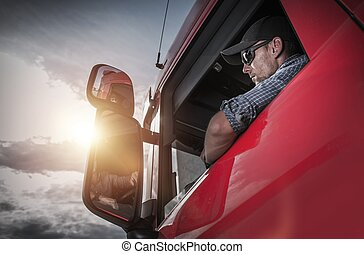 Semi Truck Driver - Red Semi Truck. Caucasian Truck Driver...