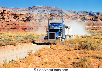 Semi-truck driving across the desert, USA