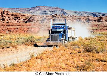 Semi-truck driving across the desert, USA