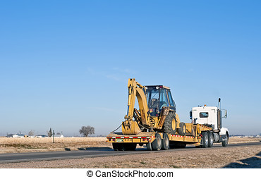 Semi-truck hauling a back-hoe loader combination - Big truck...
