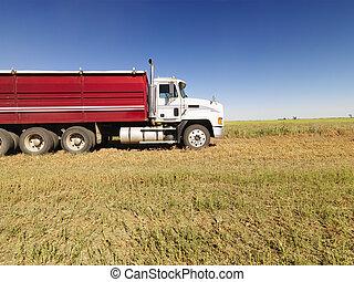 Semi truck in field.