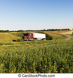 Semi truck on rural road. - Semi tractor truck on rural road...