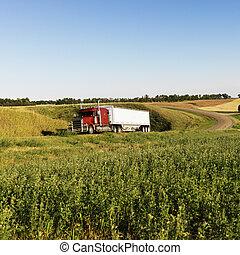 Semi truck on rural road. - Semi tractor truck on rural road...