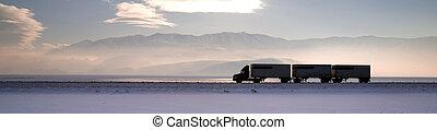 Semi Truck Travels Highway Over Salt Flats Frieght Transport...