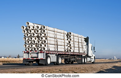 Semi-truck with a load of plastic pipe - Big truck with...