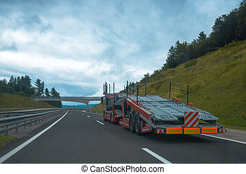 Semi truck with car carrier trailer
