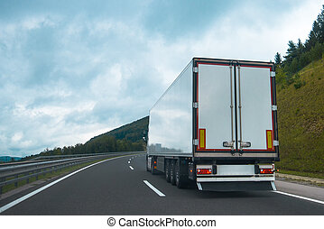 Semi truck with trailer on highway road