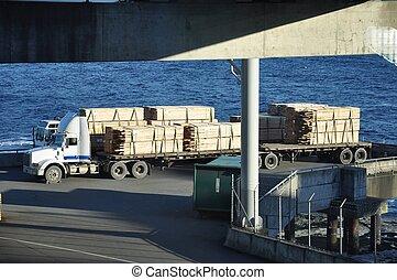 Semi Trucks Waiting to Board Ferry - Two semi trucks loaded...