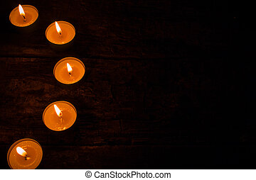 semicircle of candles on a black background