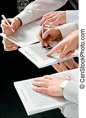 Seminar - Image of male hand pointing at a document at...