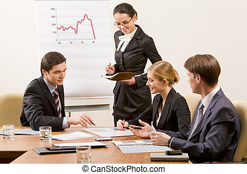 Seminar - Image of business team looking at document and...