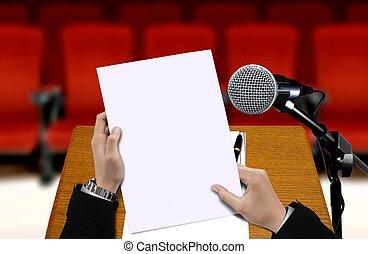 Seminar preparation with a man holding presentation sheet
