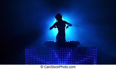 Seminude blond girl dj dancing in silhouette. Slow motion