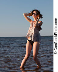 seminude woman against sea background