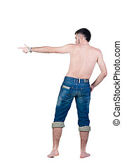 seminude young man in jeans pointing. rear view.