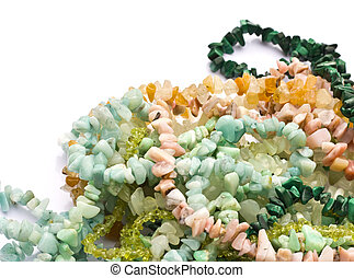 Semiprecious chip stone bead necklaces on white background