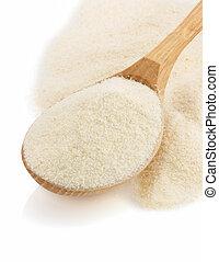 semolina flour in spoon on white