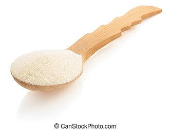 semolina in spoon on white