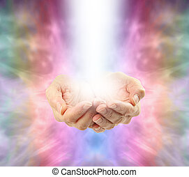 Bright healing energy emerging from Healer's cupped hands on an Angelic rainbow colored background