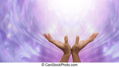 Female hands outstretched sending healing into the light above and an ethereal purple energy formation background
