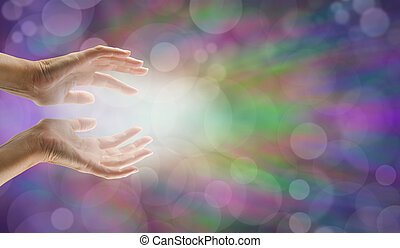 Female hands reaching out with white light and bokeh effect background