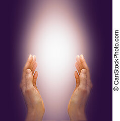 Sending distant healing - Healer's hands reaching up to ...
