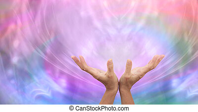 Healer's open hands sending distant healing with misty multi colored energy formation in background