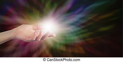 Sending healing energy - Female Healer with hand out palm up...