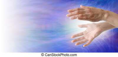 Sending Healing Energy - Pair of female hand with energy...