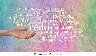 Female hand outstretched with the word 'reiki' leaving her hand, surrounded by a relevant healing word cloud on a wide rainbow colored stone effect background
