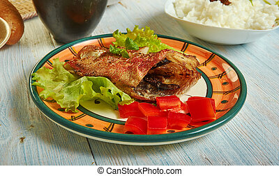 Senegalese Fish, African cuisine, Traditional assorted Asia dishes, Top view.