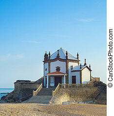 Seascape with Senhor da Pedra chapel at Miramar beach, Portugal