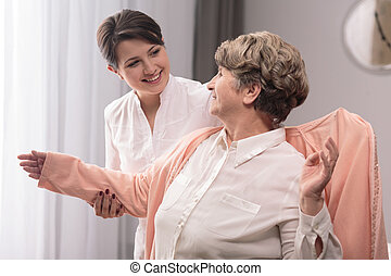 Senility can be happy period - Positive senior woman...