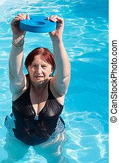 Senior active woman exercising