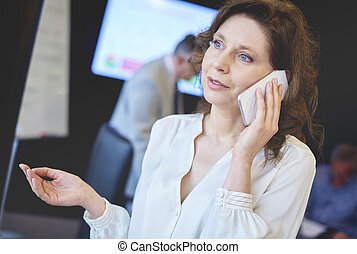 Senior adult business woman contact by the phone