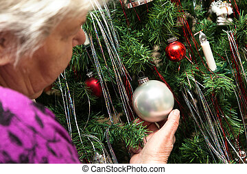 senior adult decorate a christams tree