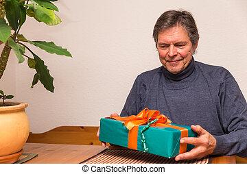 senior adult gets a gift