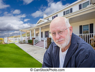 Senior Adult Man in Front of House