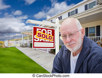 Senior Adult Man in Front of Real Estate Sign, House -...