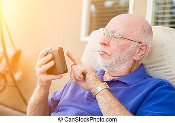 Senior Adult Man Using Smart Cell Phone.