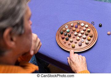 senior adult plays Sailor's Solitaire - senior citizen plays...