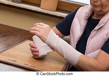 senior adult with arm bandage