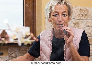 senior adult with e cigarette