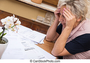 senior adult with lot of documents