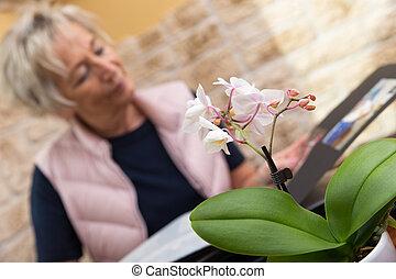 senior adult with photo album